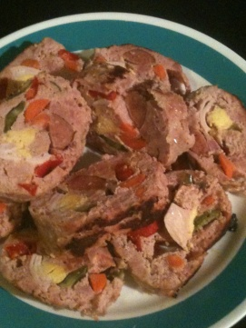 Jan 1, 2012. Embutido by my mom. Filipino version (but more complicated!) of meatloaf. That's stuffed with kielbasa, egg, red pepper, and probably more.