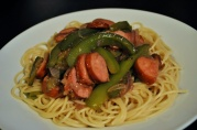 April 21, 2012. Amanda's odd version of sausage and peppers: kielbasa and green pepper on spaghetti (no tomato).